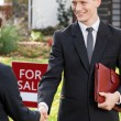 Estate agent shaking hand of client — Stock Photo #58468465