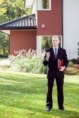 Elegant house agent wearing suit — Stock Photo