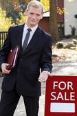 Handsome real estate broker — Stock Photo