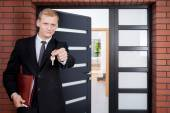 Standing in front of door — Stock Photo
