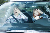 Couple blinded in a car — Stockfoto