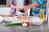 Close-up of putting ingredients for pizza — 图库照片