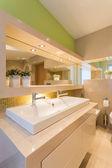Modern illuminated washroom interior — Stock Photo