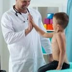 Pediatrician giving boy a five — Stock Photo #59213053