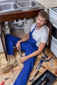 Boring work of a repairman — Стоковое фото