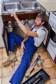 Tired handyman at work — ストック写真