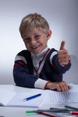 Little schoolboy showing thumb up — Stock Photo