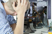Man during computer reparation — Stock Photo