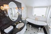 Bright bathroom in baroque style — Stock Photo