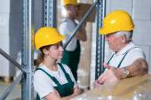 Storage workers in warehouse — Stock Photo