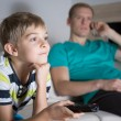 Schoolboy addicted to watching tv — Stock Photo #61900451