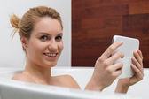 Bath with tablet — Stock Photo