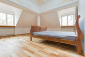 Empty room with old fashioned bed — Stockfoto