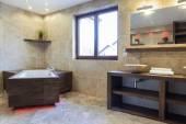 Brown bathroom in modern house — Stock fotografie