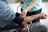 Assessment of blood pressure — Stock Photo