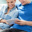Smiling couple with tablet — Stock Photo #62732561