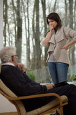Despair woman talking with therapist — Stock Photo