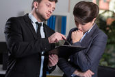 Strict boss talking with secretary — Foto Stock