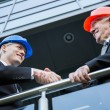 Civil engineers shaking hands — Stock Photo #63741311