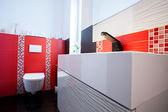 Interior of white and red bathroom — Foto de Stock