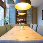 Cozy illuminated dining room — Stock Photo #64349519
