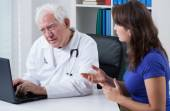 Young woman visiting her doctor — Stock Photo