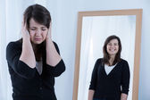 Woman and her reflection — Stock Photo