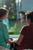 Ill woman talking with kindly nurse — Stock Photo