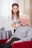Social care worker and senior — Stock Photo