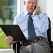 Disabled man talking on phone — Stock Photo #67392837