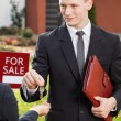 Estate agent gives keys to client — Stock Photo #67884201