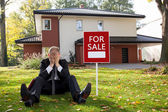 Estate agent sitting outside the house — Stock Photo