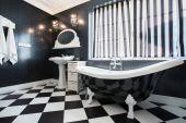 Black and white bathtub in bathroom — Stock Photo