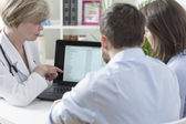 Gynecologist analyzing tests results — Stock Photo