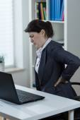 Backache caused by sedenary work — Stock Photo