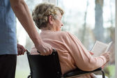 Disabled woman in retirement home — Stock Photo