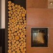 Fireplace and wood pieces — Stock Photo #69228305