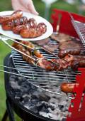 Delicious sausages prepared on grill — Stock Photo