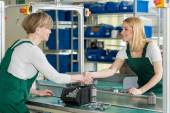 Female line workers — Stock Photo