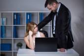 Businessman seducing assistant — Stock Photo