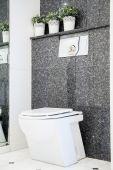Toilet in marble bathroom — Stock Photo