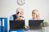 Elderly people running a company — Stock Photo