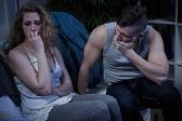 Crying woman and terrified husband — Stock Photo