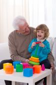 Grandpa and kindergartner — Stock Photo