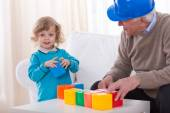 Toddler playing with colorful cubes — Stock Photo