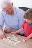 Grandfather teaching preschooler alphabet — Stock Photo