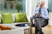 Elderly man using mobile phone — Stock Photo