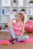 Fit girl at home — Stock Photo