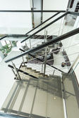 Modern glass staircase in apartment — Stock Photo