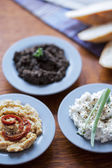 Hummus, tapenade and cottage cheese — Stock Photo